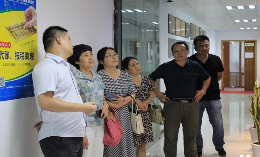 热烈欢迎新疆供销技师学院考察团一行来我司考察交流